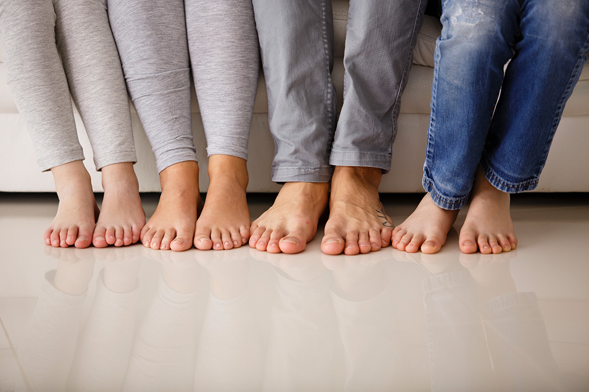 Bare foot family utilising their underfloor heating